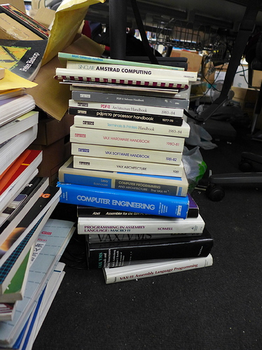 A mixed stack of books, two micro-related and the rest DEC